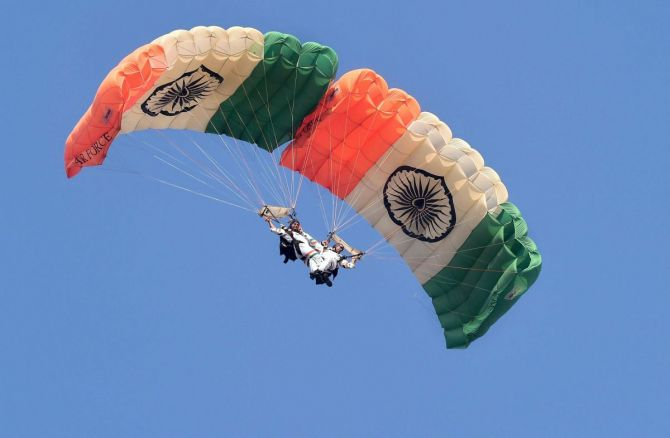 An Indian Air Force paratrooper performs during the 88th Air Force Day parade at Hindon airbase in Ghaziabad.