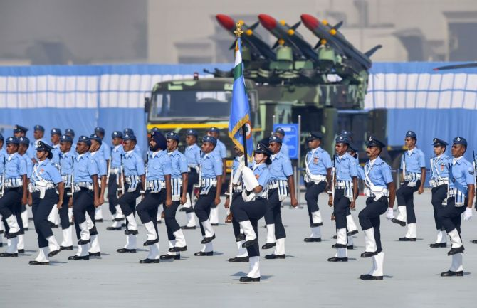 IAF personnel march past during the 88th Air Force Day celebrations.