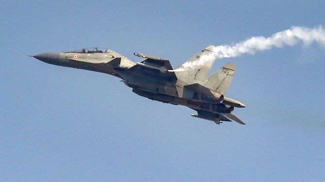 IAFs Su-30 MKI fighter aircraft fires flares during the 88th Air Force Day parade at Hindon airbase in Ghaziabad.